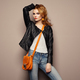 Fashion portrait of beautiful young woman with handbag - PhotoDune Item for Sale
