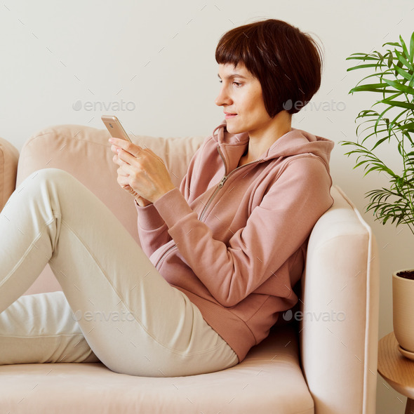 Portrait of mature woman looking social media on mobile phone. Middle-aged female - Stock Photo - Images