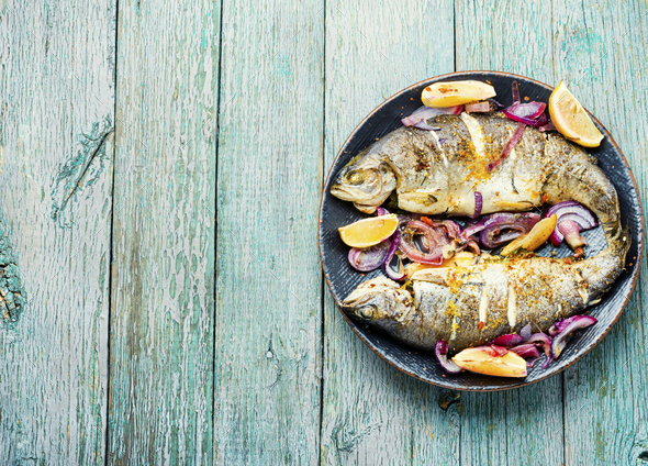 Baked trout with lemon,fish dish - Stock Photo - Images