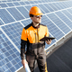 Engineer servicing solar panels on electric plant - PhotoDune Item for Sale