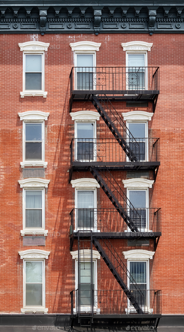Old brick building with fire escape, New York City, USA. - Stock Photo - Images