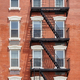 Old brick building with fire escape, New York City, USA. - PhotoDune Item for Sale