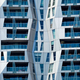 Modern residential building facade with windows and balconies. Rotterdam - PhotoDune Item for Sale