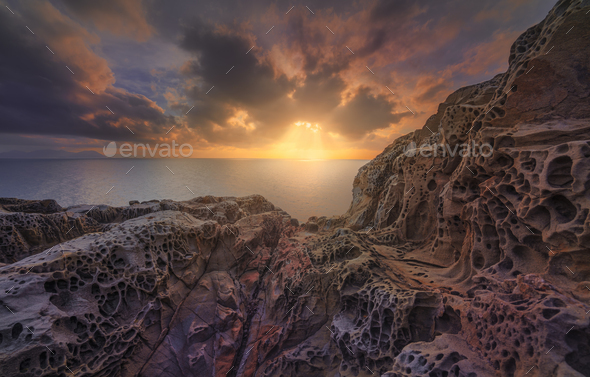 Sea at sunset and rocks eroded. Populonia, Buca delle Fate. Piombino, Maremma Tuscany, Italy. - Stock Photo - Images