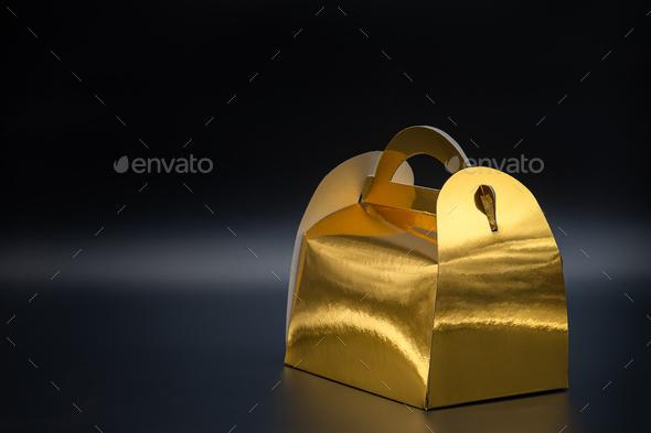 Golden box on black background - Stock Photo - Images