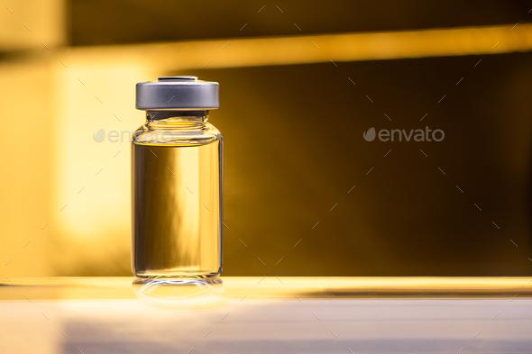 Luxury golden vaccine bottle - Stock Photo - Images