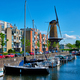 View of the harbour of Delfshaven and the old grain mill De Destilleerketel. Rotterdam, Netherlands - PhotoDune Item for Sale