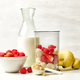 fresh banana pieces and red berries in plastic transparent blender container - PhotoDune Item for Sale
