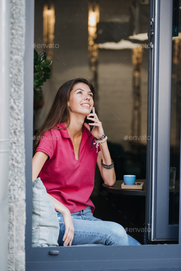 Slender slim brunette girl talking on the cell phone in cafe. Body health, slimness, self-love - Stock Photo - Images