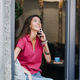 Slender slim brunette girl talking on the cell phone in cafe. Body health, slimness, self-love - PhotoDune Item for Sale