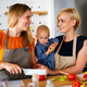 Happy lesbian female couple with her little child at home - PhotoDune Item for Sale
