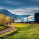 Moving train in mountains at sunset in autumn - PhotoDune Item for Sale