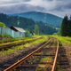 Railroad in mountains in overcast summer day - PhotoDune Item for Sale
