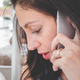 Brunette girl with a cell phone - PhotoDune Item for Sale