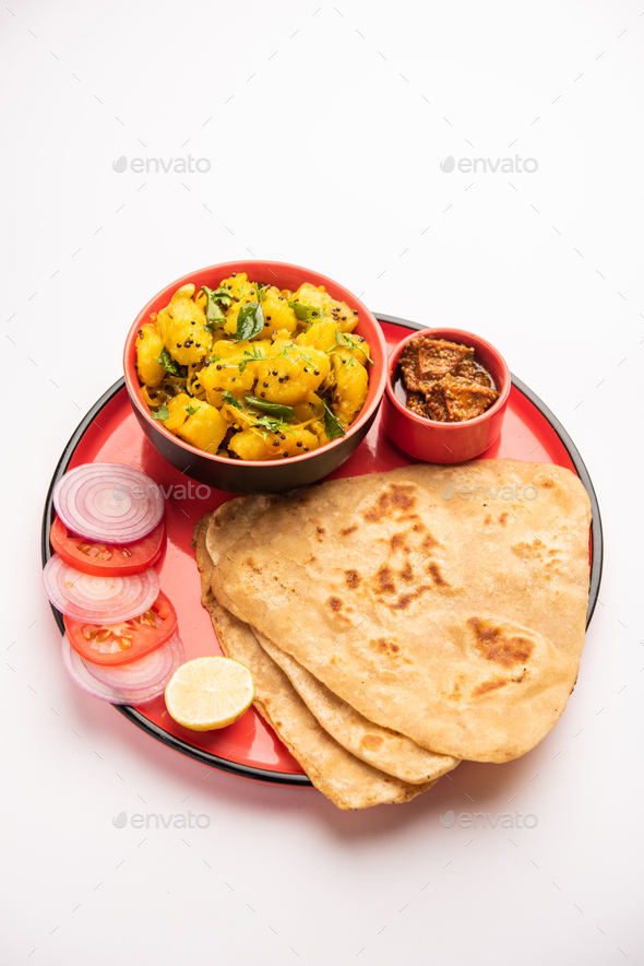 Potato or Aloo Sabji with Triangle Paratha. Indian food - Stock Photo - Images