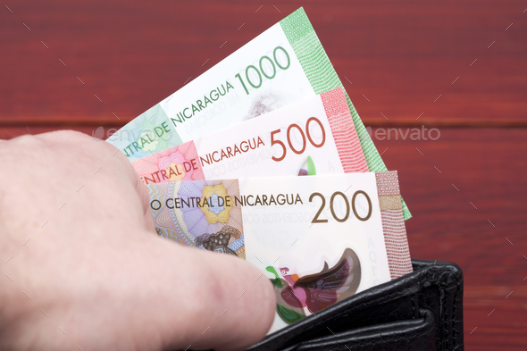Nicaraguan cordoba in the black wallet - Stock Photo - Images