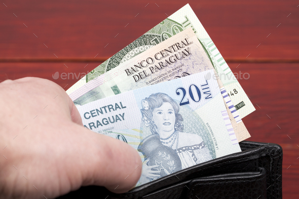 Paraguayan guarani in the black wallet - Stock Photo - Images