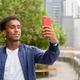 Portrait of handsome black African man at rooftop garden - PhotoDune Item for Sale