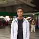 Portrait of handsome black African man with cool attitude at skytrain station in Bangkok - PhotoDune Item for Sale