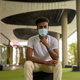 Portrait of handsome black African man sitting wearing face mask while thinking - PhotoDune Item for Sale