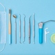 Dentist tools over blue background top view - PhotoDune Item for Sale