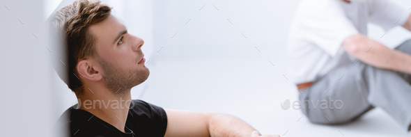 Therapy with its emphasis on vulnerable face-to-face sharing, presents challenges for men - Stock Photo - Images