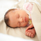 Newborn baby girl sleeping in bed. - PhotoDune Item for Sale