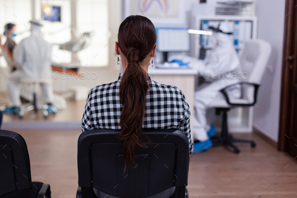 Back view of woman in dentist office waiting for consultation - Stock Photo - Images