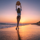 Beautiful woman with straw hat is standing in sea with waves - PhotoDune Item for Sale
