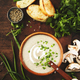 Creamy Mushroom Soup with croutons, spices and chives on rustic wooden table - PhotoDune Item for Sale