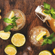Ginger Ale Cocktail with Beer, Lime, Lemon and Mint in glass on wooden table - PhotoDune Item for Sale