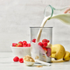 fresh milk pouring into blender container - PhotoDune Item for Sale