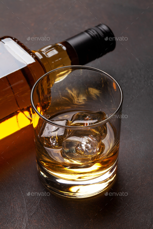 Scotch whiskey bottle and glass - Stock Photo - Images