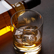 Scotch whiskey bottle and glass - PhotoDune Item for Sale