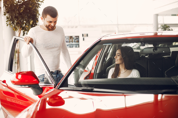Stylish and elegant family in a car salon - Stock Photo - Images