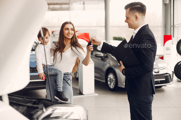 Stylish and elegant woman in a car salon - Stock Photo - Images