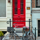 Bicycle near door of old house in Amsterdam street - PhotoDune Item for Sale