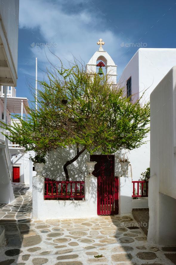 Greek Mykonos street on Mykonos island, Greece - Stock Photo - Images