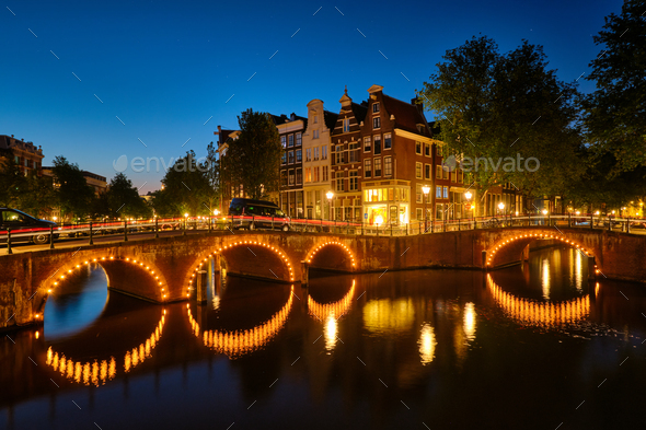 Amterdam canal, bridge and medieval houses in the evening - Stock Photo - Images