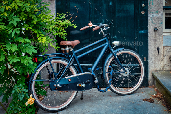 Bicycle near door of old house in Amsterdam street - Stock Photo - Images