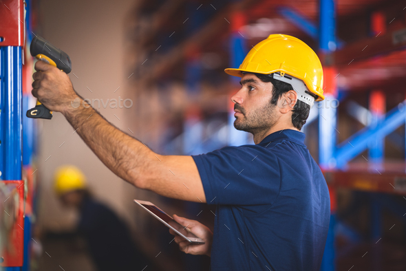Worker with scanner making review of goods in warehouse storage, logistic industry concept - Stock Photo - Images