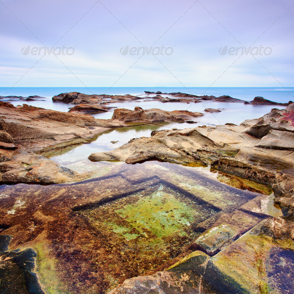 Le Vaschette water pool and rocks seascape near Livorno. Italy.  - Stock Photo - Images