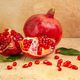 Front close-up view (pomegranate) was put next to a pomegranate divided into parts scattered seeds a - PhotoDune Item for Sale