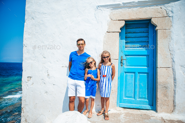 Family having fun outdoors on Mykonos island - Stock Photo - Images