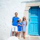 Family having fun outdoors on Mykonos island - PhotoDune Item for Sale