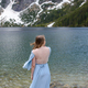 Portrait of a young woman on the background of the Polish lake Sea Eye in the Tatra Mountains. - PhotoDune Item for Sale
