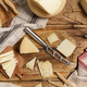 Pieces of  fresh homemade cheese on a wooden board with a knife - PhotoDune Item for Sale