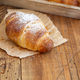 French fresh crusty croissants on a wooden table - PhotoDune Item for Sale