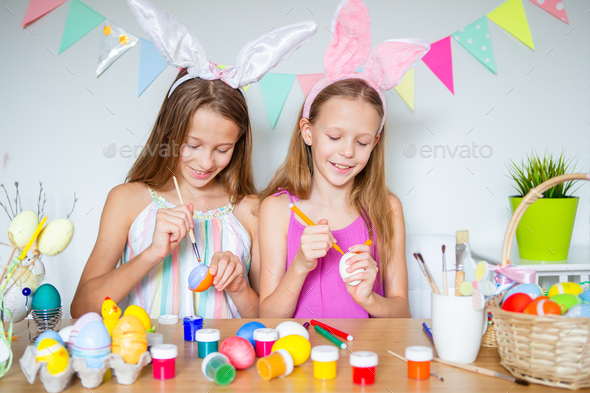 Happy easter. Beautiful little kids wearing bunny ears on Easter day - Stock Photo - Images