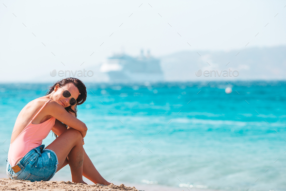 Young beautiful woman on the beach during tropical summer vacation - Stock Photo - Images